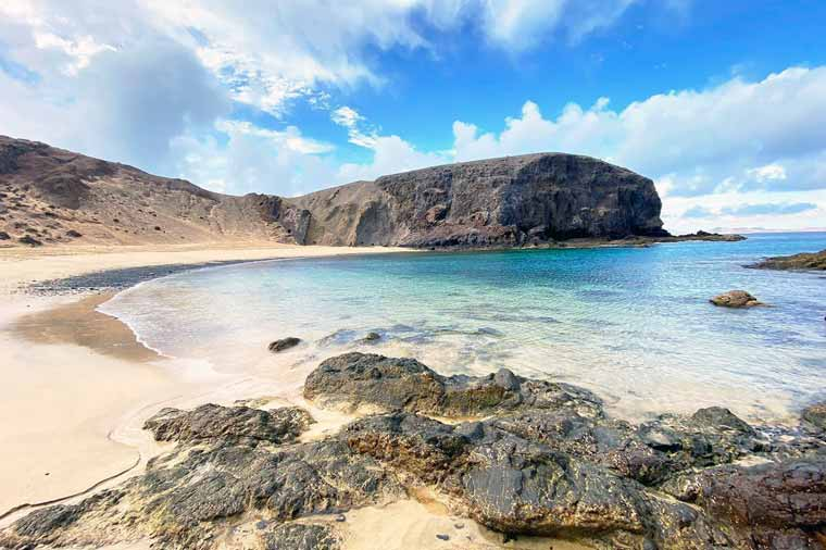 Visit Lanzarote to visit the golden sand beaches like Papagayo